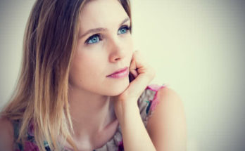Woman with Blue Eye Thinking