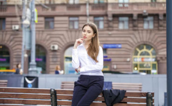 young business woman in white shirt on summer street city